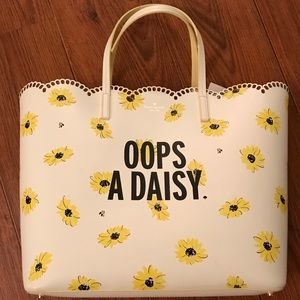 Oops a daisy Kate Spade